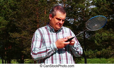 Man with a badminton racket 5