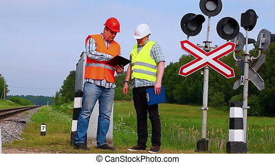 Railroad workers with folders 1