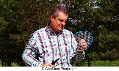 Man with a badminton racket 1 - Man with a badminton racket...