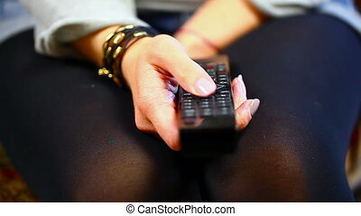 Woman with remote control in hand 2 - Woman with remote...