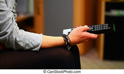Woman with remote control in hand 1