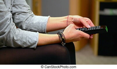 Woman with remote control in hand 5 - Woman with remote...