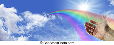 Vanishing Rainbow - Wide blue sky with fluffy clouds and a...