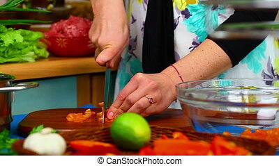 Woman preparing food 2 - Woman preparing food in the kitchen...