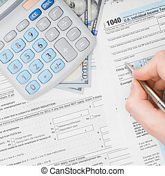 Man filling out 1040 US Tax Form - view from top - 1 to 1...