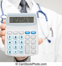 Doctor holding calculator - closeup shot - 1 to 1 ratio