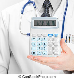 Doctor holdling calculator - heath care concept - 1 to 1...