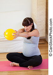 Keeping fit during pregnancy - Vertical view of keeping fit...