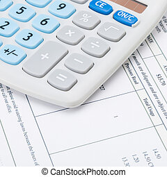 Studio shot of receipt and calculator - 1 to 1 ratio