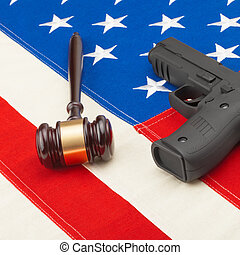 Gun and judge gavel over USA flag - studio shoot - 1 to 1...