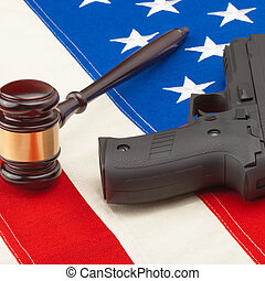 Gun and judge gavel above USA flag - 1 to 1 ratio