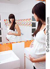 Pregnant woman in a bathroom
