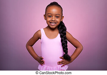 Cute little African American girl dancing - Portrait of a...
