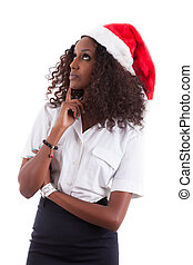 Young African American woman wearing a santa hat, isolated...