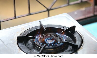 gas lights and goes out on a gas stove near the window