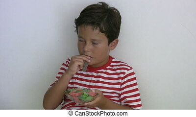 Obesite and Unhealthy Eating - Child eating jellybean