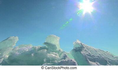 Winter landscape - Winter Baikal Ice against clear sky and...