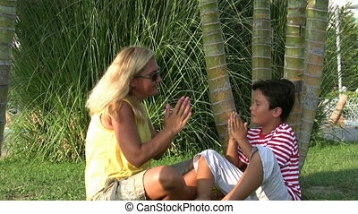 Mother and son relaxing time in park