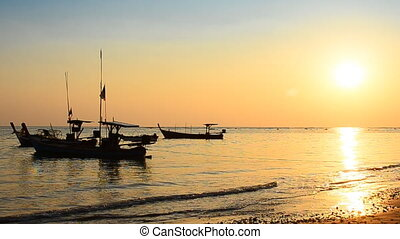 Boat at beach and sunset in evening