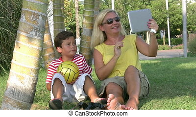 Mother and son sitting in the park
