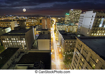 Full Moon Rising Over Portland Oregon Cityscape with Long...