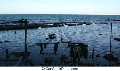 old wooden pier - Sea wave impinges on an old wooden jetty...