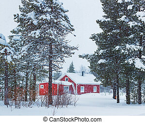 Finnish house - Red wooden Finnish house in winter forest...