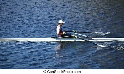 Single scull rowing - Sculling rowing tracking shot