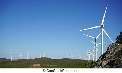 Wind turbines at top of the mountain, blue sky