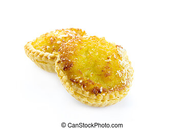 Sweet Coconut tarts on white background