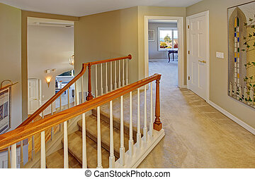 Upstairs hallway with staircase. Staircase with carpet...