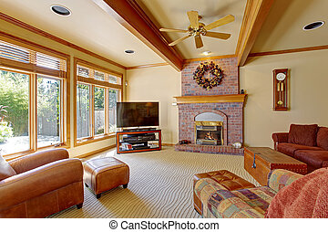 Living room with brick fireplace and ceiling beams