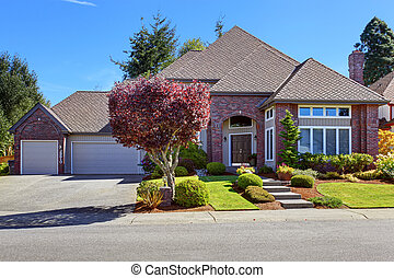Luxury house with brick wall trim and beautiful curb appeal...
