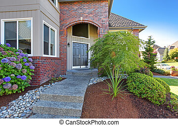Luxury house entrance porch with brick trim