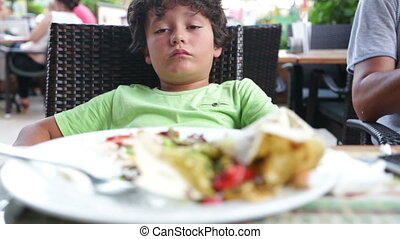 Full child cant eating - Boy have a full stomach