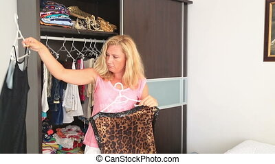 Woman chooses a dress - Women dont know what to wear