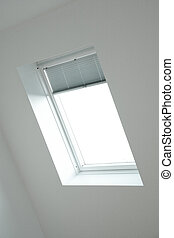Roof window with back-light and white wall