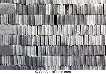 stack of cinder block wall background, brick texture - Stack...