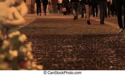 Night Pedestrians - Night people walking over the wet...