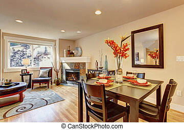 Served dining table with flowers - Cozy living room with...
