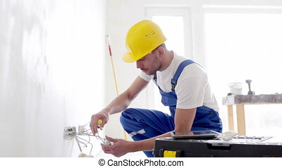 builder with tablet pc and equipment indoors - building,...