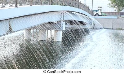 Curved Metal Bridge over the water with fountain Horizontal...