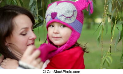 daughter with her mother in autumn