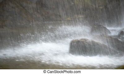 Waterfall with large rocks