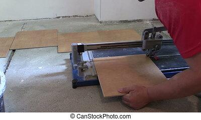 worker cut tile