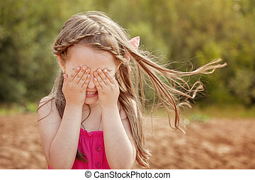 Cute little girl playing hide and seek with camera - Funny...