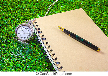 Fountain pen - fountain pen and pocketwatch on book