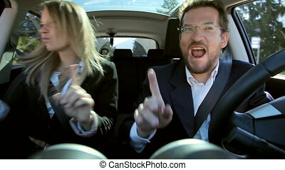 Two business people in car dancing