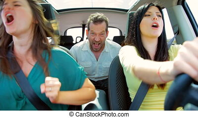 Three happy people in car driving