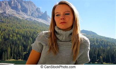 Sad woman in the mountain